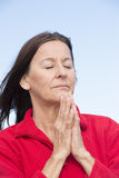 Praying woman relaxed and closed eyes Royalty Free Stock Images