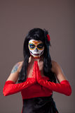 Praying woman with sugar skull make-up. The Day of the Dead royalty free stock image