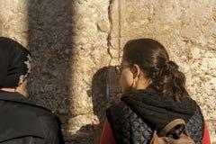 Praying woman at Western wall Stock Photo
