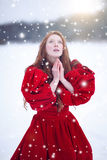 Praying woman in winter Royalty Free Stock Photography