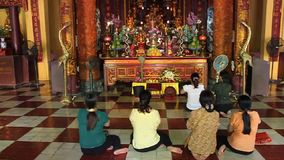 Praying women in a temple Royalty Free Stock Photography