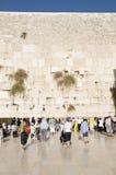 Praying women and tourists near Jerusalem wall Stock Images
