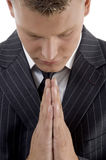 Praying young businessman Stock Photos