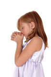 Praying young girl. Royalty Free Stock Images