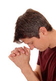 Praying young man in profile. Royalty Free Stock Photography