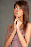 Praying young woman in brown blouse Royalty Free Stock Photos