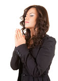 Praying young woman with folded hands Stock Photos