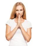 Praying young woman Stock Photo