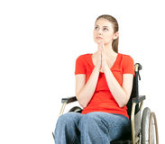 Praying young woman on wheelchair Stock Photography