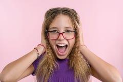 Prazer, felicidade, alegria, vitória, sucesso e sorte Menina adolescente em um fundo cor-de-rosa fotografia de stock royalty free