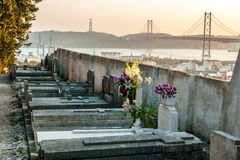Prazeres Cemetery in Lisbon, Portugal. Sunset in the Prazeres Cemetery, Lisbon. In the background the 25th of April Bridge and The Christ the King statue Royalty Free Stock Photo