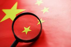 The PRC flag is looked through a magnifying glass. Spies and sightings of the People s Republic of China. Monitoring the status of. The People`s Republic of royalty free stock images