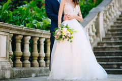 Prcanj, Montenegro, the bride and groom on the stairs. Wedding i Stock Photography