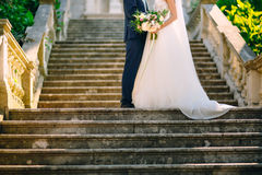 Prcanj, Montenegro, the bride and groom on the stairs. Wedding i Stock Photos