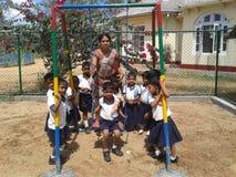 Pre ребеята школьного возраста с их учителем Стоковое Изображение RF