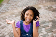 Pre-Adolescent talking on cellphone Royalty Free Stock Image