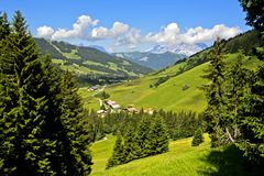 Pre-alpine landscape with pastures and forests in summer. The hamlet Planay in pre-alpine landscape with pastures and forests in summer, hiking area Megeve royalty free stock photos