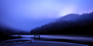 Pre-dawn at Big River. During a foggy morning sunrise in Mendocino, CA Royalty Free Stock Photo