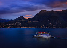 Pre-dawn ferry from Varenna toward Belagio. Ferryboat commuting on Lake Como, Italy Royalty Free Stock Image