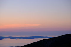 Pre-dawn golden glow from the top of Cadillac Mountain with the Stock Photography