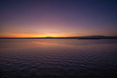 Pre-dawn light on the lake Royalty Free Stock Photos