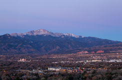 Pre Dawn shot of Pikes Peak and Colorado Springs, Colorado. Pikes Peak and  Colorado Springs starts to come alive in the early morning with the Garden of the Stock Images