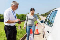 Pre driving inspection. Confident female learner driver with instructor doing pre driving inspection stock photos