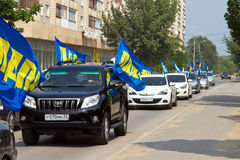 Pre-election campaign 2013 of LDPR. VOLGOGRAD - AUGUST 12: Pre-election campaign 2013. The column of cars with flags of the liberal democratic party travels to Stock Photography