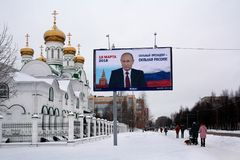 Pre-election poster in Russia. Yoshkar-Ola, Russia - January 14, 2018 Epre-election poster in Russia on a billboard featuring Vladimir Putin with the slogan A Stock Image