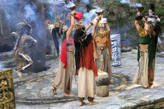 Pre-Hispanic Mayan amerindian people performance into the jungle in the ancient Mayan Village. Riviera Maya, Yucatan, Mexico royalty free stock images