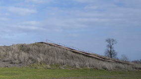 Pre-historic Cahokia Mounds, IL. Time lapse of People walking up the prehistoric Monks Mound of Cahokia, IL stock footage