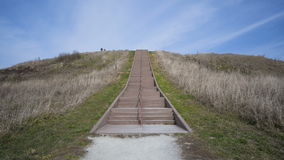 Pre-historic Cahokia Mounds, IL. Time lapse of People walking up the prehistoric Monks Mound of Cahokia, IL stock video footage