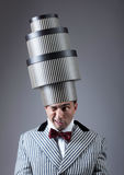 Pre-holiday fuss concept. Troubled man with the stacked gift boxes on his head Stock Photography