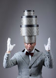 Pre-holiday fuss concept. Troubled man with the stacked gift boxes on his head Royalty Free Stock Photo