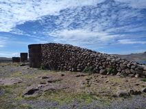 Pre-incan burrial site sillustani with chulpas Royalty Free Stock Photo