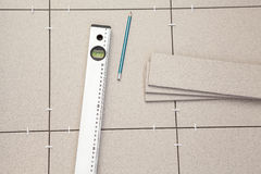 Pre-laying tiles on floor and level tube Stock Photography
