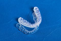 Pre-orthodontic dental trainer alignment appliance. On blue background, closeup Stock Photography