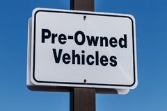 Pre Owned Vehicles sign at a Used Car Dealership I. Pre Owned Vehicles sign at a Used Car Dealership stock photography