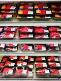 Pre packed meat in supermarket shelves Stock Photos