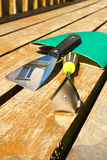 Pre-painting preparation tools. Pre-painting preparation scraping tools and reflection of the house Stock Photography