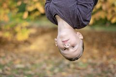 Pre-school age boy upside down outdoors royalty free stock photos