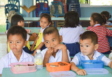 Pre-school age,Student at luch time  in Thailand. Pre-school age,student in Thailand before  lunch time  at their school.  Ban Ku Mueng  School ,Srisaket Royalty Free Stock Photography