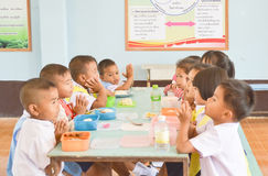 Pre-school age,Student at luch time  in Thailand. Pre-school age,student in Thailand  praying before  lunch time  at their school.  Ban Ku Mueng  School Stock Image