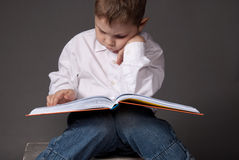 Pre-school boy reading a book Royalty Free Stock Photo