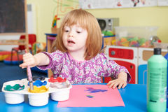 Pre School Child Painting Picture In Classroom
