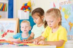 Pre-school children in the classroom Stock Images