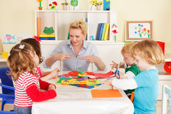 Pre-school Children In The Classroom With The Teacher Stock Photography