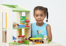 Pre-School Pupil Playing With Wooden House Stock Photo