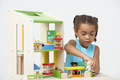 Pre-School Pupil Playing With Wooden House Stock Images