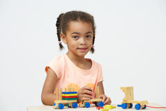 Pre-School Pupil Playing With Wooden Toy Train Stock Photo